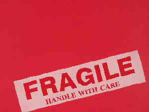 Parcel: Labeled 'HANDLE WITH CARE'