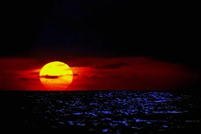 Deep Red-Orange Sunset Over Ocean